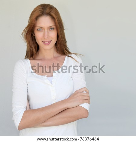 Beautiful woman standing on white background - stock photo