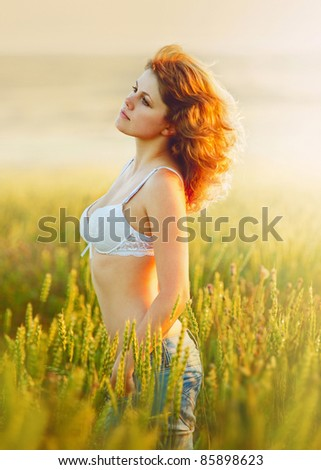 beautiful woman staying on the field