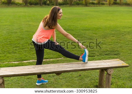 Beautiful woman stretching her muscles after finish the workout - stock photo