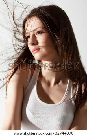 beautiful woman studio portrait with flying hair