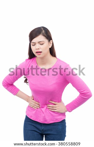 Beautiful woman suffering from stomachache - stock photo