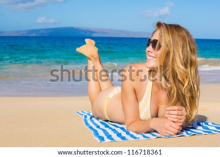 Beautiful Woman Sunbathing on Tropical Beach