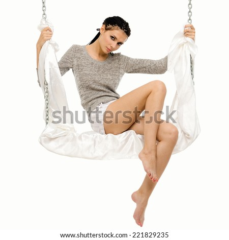Beautiful woman swinging on a swing. Isolated image