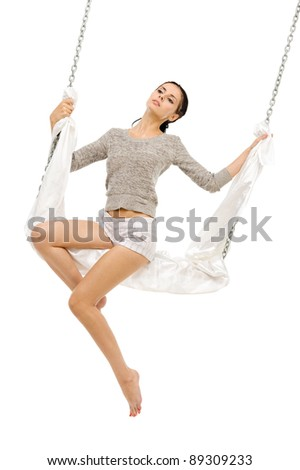 Beautiful woman swinging on a swing. Isolated image - stock photo