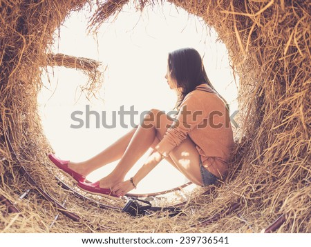 Beautiful woman taking her shoes with retro style filter effect - stock photo