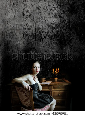 beautiful woman taking inspiration for writing romantic letter - stock photo