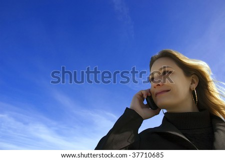 beautiful woman talking at mobile phone - stock photo