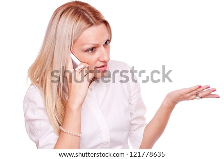 Beautiful woman talking on a mobile phone and brandish with the second hand - stock photo