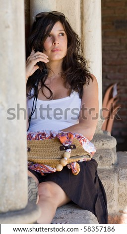 Beautiful woman talking on cell phone - stock photo