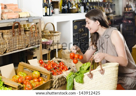 Beautiful woman talking on the phone receiving orders in a rustic store - stock photo