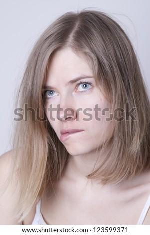 Beautiful woman thinking - stock photo
