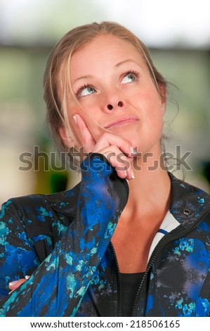 Beautiful woman thinking and deep in thought - stock photo