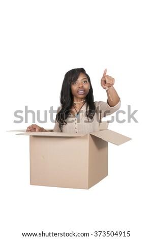 Beautiful woman thinking outside of the box - stock photo