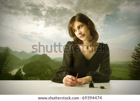Beautiful woman thinking while writing with landscape on the background - stock photo