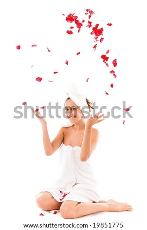 Beautiful woman throwing petals of roses for the high.