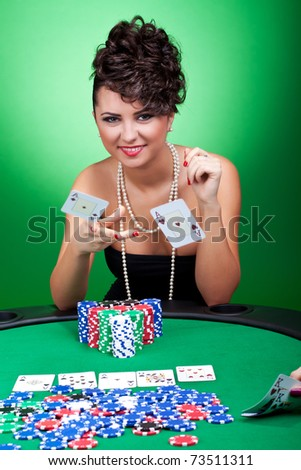 beautiful woman throwing two aces on the table, playing against pair of kings