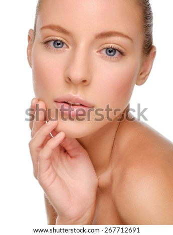Beautiful Woman Touching her Face. Beauty face of young woman. Skin care concept. Closeup portrait isolated on white. Pure Beauty Model. - stock photo