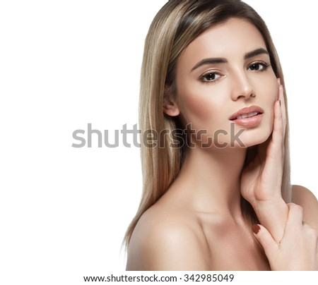 Beautiful woman touching her face looking camera portrait
