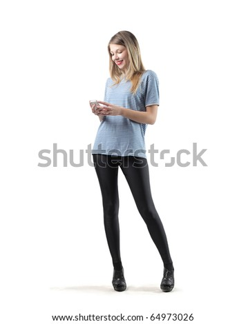 Beautiful woman using a mobile phone - stock photo