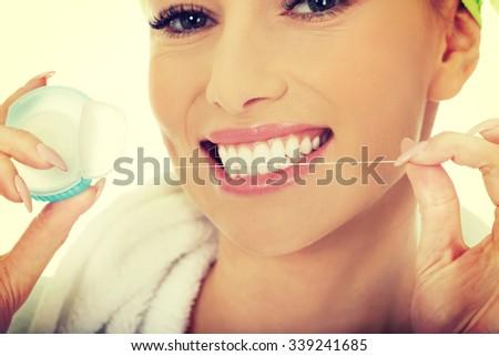 Beautiful woman using dental floss. - stock photo