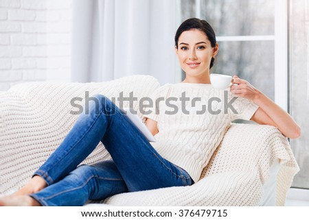 Beautiful woman using digital tablet at home - stock photo