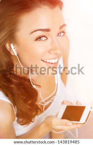beautiful woman using mobile phone high angle portrait from above - stock photo
