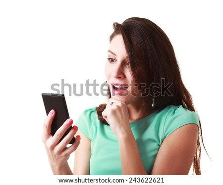 Beautiful woman using mobile telephone or smartphone surprised - stock photo