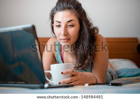 beautiful woman using notebook at home - stock photo