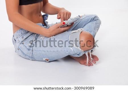 Beautiful Woman Using Smart phone in studio - stock photo