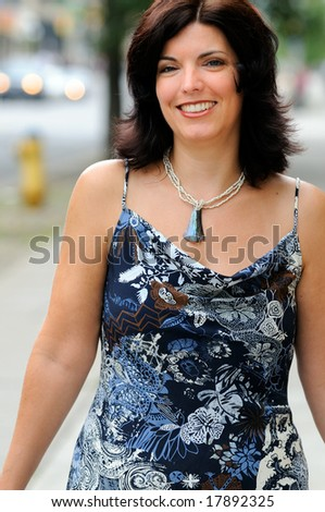 Beautiful Woman Walking In The City - stock photo