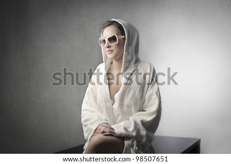 Beautiful woman wearing a bathrobe - stock photo