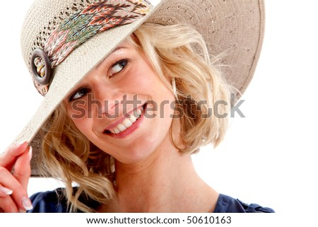 Beautiful woman wearing a hat and smiling - isolated over a white background - stock photo