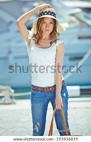Beautiful woman wearing a hat at the sea
