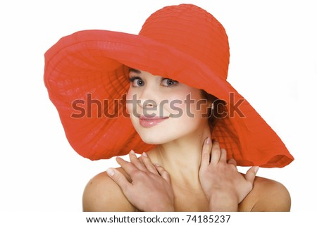 Beautiful woman wearing a hat, isolated on white background - stock photo