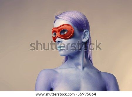 Beautiful woman wearing a red mask