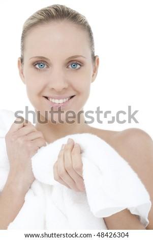 Beautiful woman wearing bathrobe - stock photo