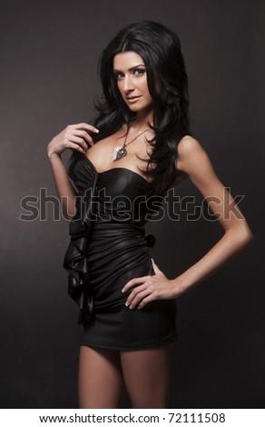Beautiful woman wearing black dress - stock photo