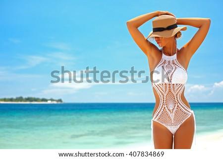 Beautiful woman wearing crochet bikini posing over the sea view, beach lifestyle - stock photo