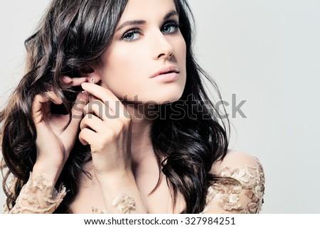 Beautiful Woman Wearing Earrings - stock photo