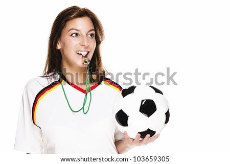 beautiful woman wearing football shirt with a whistle holding football on white background - stock photo