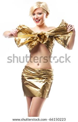 Beautiful woman wearing gold ribbon - stock photo