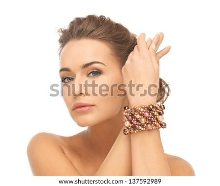 beautiful woman wearing hand jewelry with beads - stock photo
