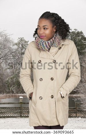 Beautiful woman wearing her winter coat and scarf - stock photo