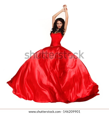 Beautiful woman wearing in magnificent red dress isolated on white background. Studio photo. Fashion. - stock photo