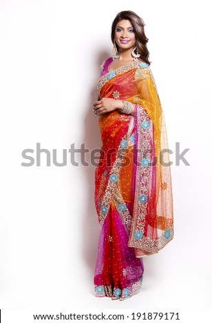 beautiful woman wearing indian traditional outfit on white background
