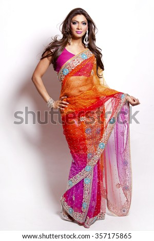 beautiful woman wearing indian traditional outfit on white background - stock photo