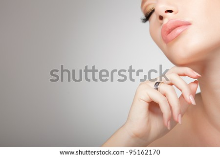 beautiful woman wearing jewelry, very clean image with copy space