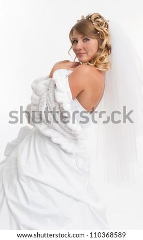 beautiful woman wearing luxurious wedding dress. Bride - stock photo