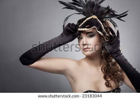 Beautiful woman wearing masquerade costume and mask - stock photo