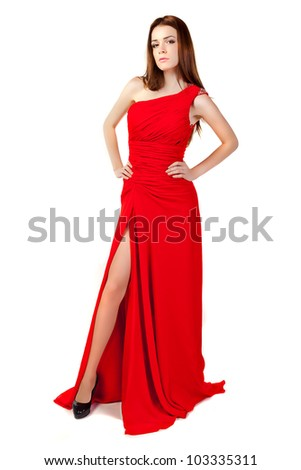 Beautiful woman wearing red dress. Fashion photo.